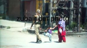 A Kashmiri Kid kicks an Indian Soldier in the besieged city of Srinagar. (Dar Zubair)